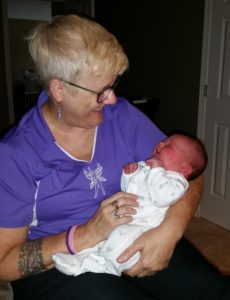 Me getting to hold Clara when she was 15 hours old.
